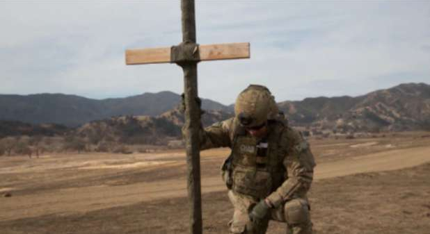 Christian soldier at cross