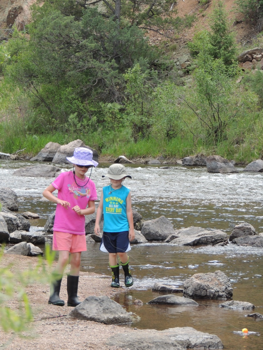 Naomi and Ben walking along river June 2017
